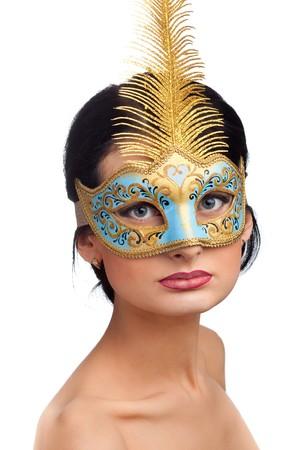 Portrait of beautiful woman wearing blue carnival mask photo