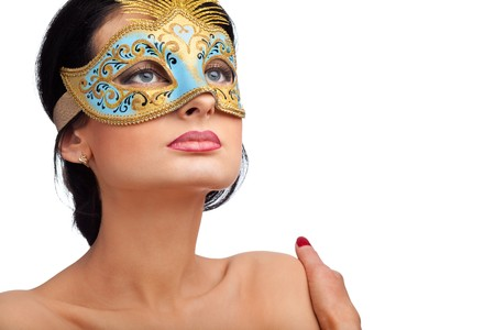Portrait of attractive beautiful young woman wearing blue carnival mask photo