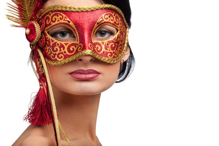 beautiful young woman wearing red carnival mask photo
