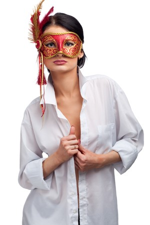 attractive beautiful young woman wearing red carnival mask photo