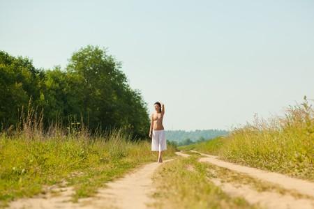 nude  beautiful girl walking in the field photo