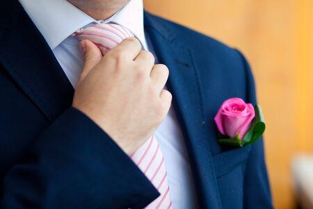 Groom set  the tie straight