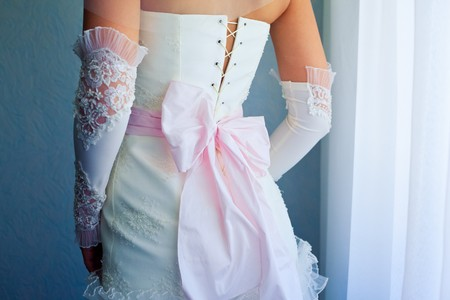 girl in dress: Image of back of bride in wedding dress