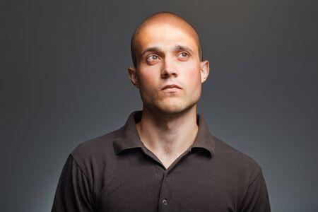 baffle: pensive young man in shirt Stock Photo
