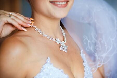 adornment: Beautiful adornment on neck of young bride