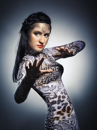 studio shot of woman in shape of snake photo