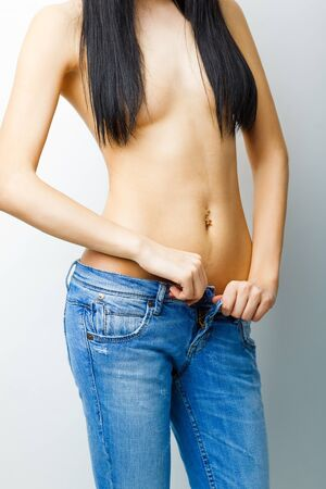 Sexy, fit woman in jeans, with naked stomach photo