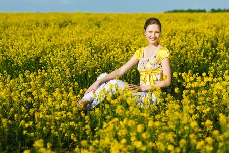 happy woman on yellow field photo