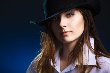 Young woman with hat and black eyeshadow photo