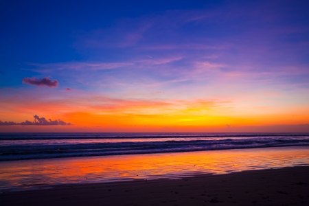 Tropical sunset on the beach. Bali island. Indonesia