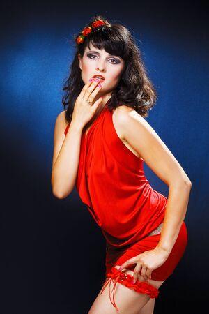 lovely girl in red dress over black photo
