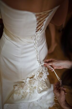 girdle: clothe in beautiful brides dress Stock Photo