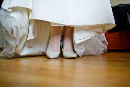 closeup photo of beautiful brides shoes photo