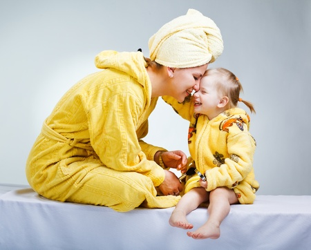 bathrobes: Daughter and mother putting makeup after bathroom