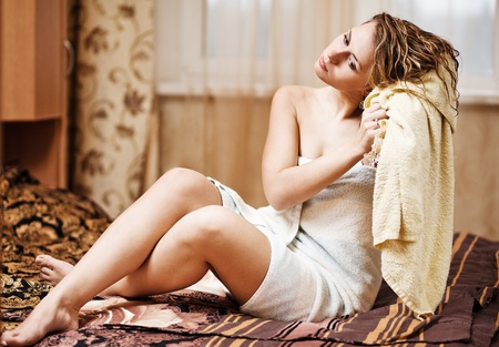 young woman wearing yellow bath towel Stock Photo