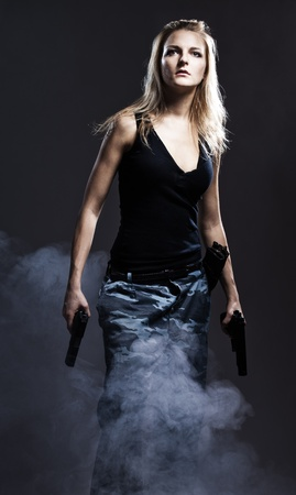 revolver: Sexy woman holding gun with smoke