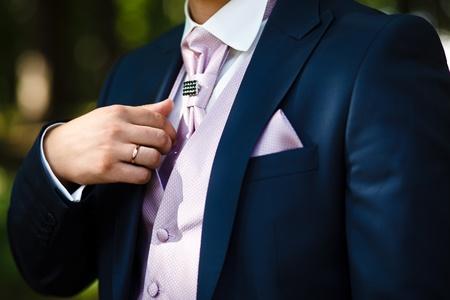 Groom set  the tie straight photo