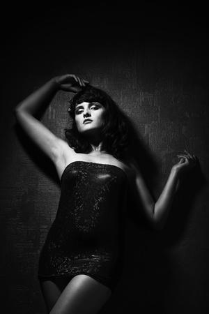 studio portrait of pretty fashionable girl photo