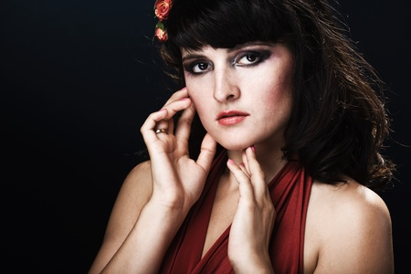 Beautiful face of a glamour woman with brightly makeup photo