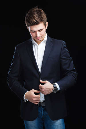 Fashion young businessman black suit on dark  background Stock Photo - 12515123