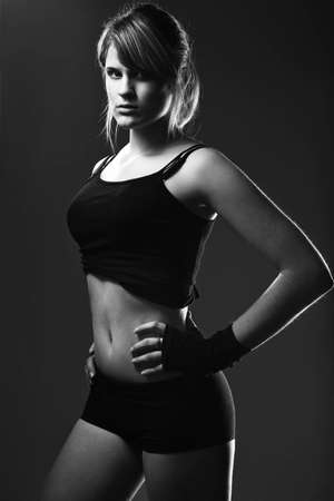beautiful young sporty muscular woman photo