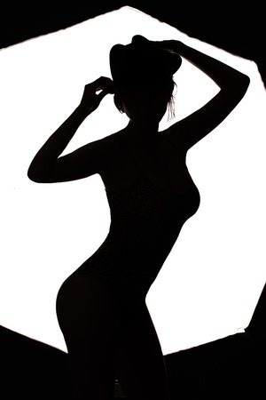 seductress: stylish silhouette beautiful woman dancing cabaret isolated white background