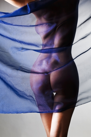 young naked woman with blue cloth closing bottom of body