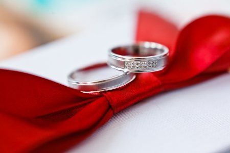 gold wedding rings on red photo