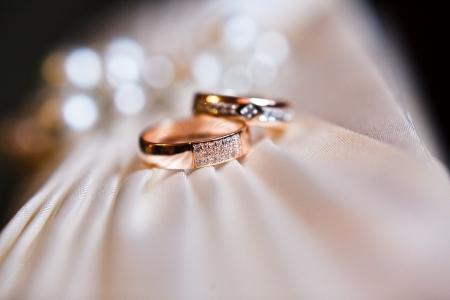 ring finger: gold wedding rings on the pincushion