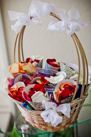 Wedding rose petals wrapped in paper photo