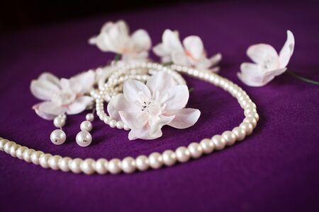 frippery: wedding Beautiful adornment on purple Stock Photo