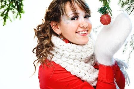 girl holding christmas ball. Isolated photo