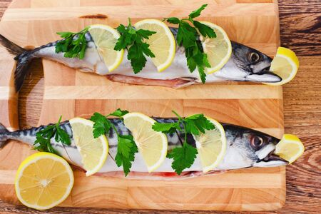 couple of fresh mackerel on wood photo