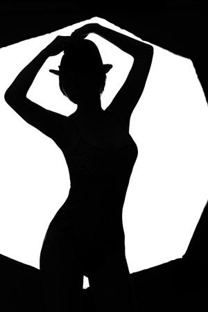 stylish silhouette beautiful woman dancing cabaret isolated white background photo