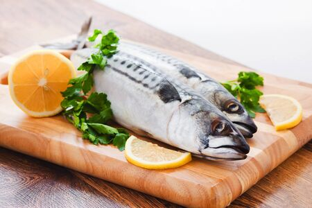 couple of fresh mackerel on wood Stock Photo - 16418361