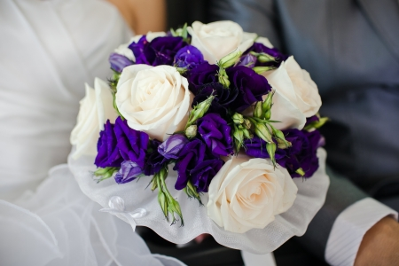 Bride with wedding  bouquet, closeup photo