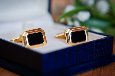 cuff links: cufflinks on the blue leather box Stock Photo