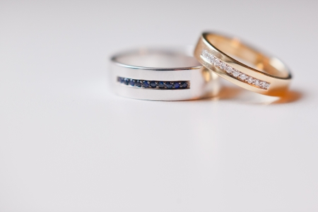 gold wedding rings on white photo