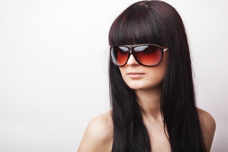 Fashion photo of young sensual woman in sunglasses photo