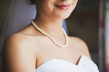 adornment: adornment on neck of bride