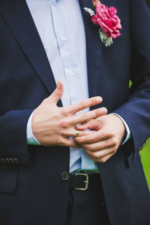 cufflink: Close-up of elegance man hands with ring, and cufflink
