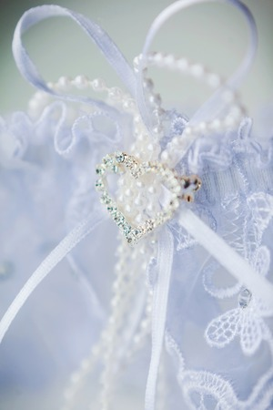 A white linen garter with a blue bow photo