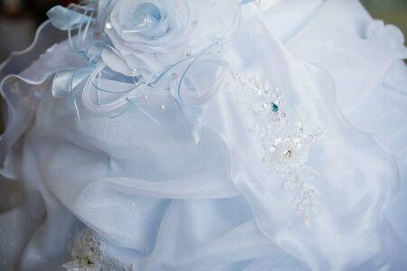 a frill: beautiful wedding dress close up Stock Photo