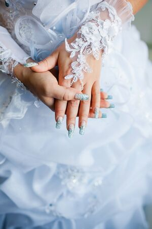 a frill: beautiful wedding dress close up Stock Photo