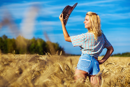 hi hat: Young american cowgirl woman portrait outdoors