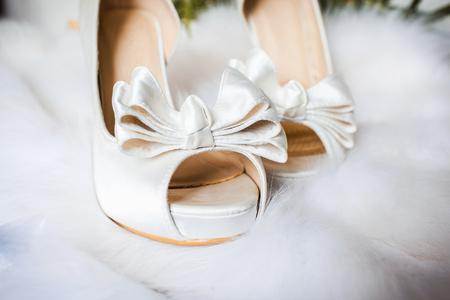 gait: closeup photo of beautiful brides shoes