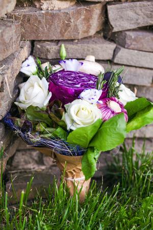 unusual vegetables: The original unusual edible bouquet of vegetables on a rocks