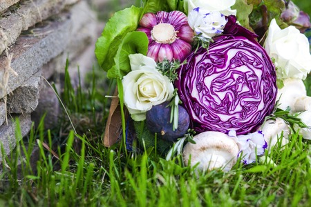 unusual vegetables: The original unusual edible bouquet of vegetables on a grass Stock Photo