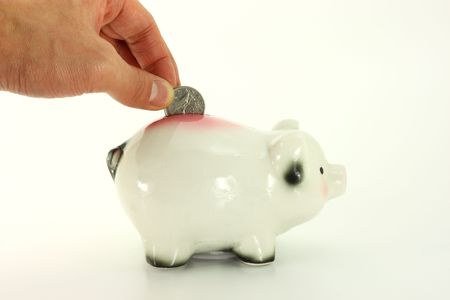 Deposit Coin In Piggy Bank Isolated On White 版權商用圖片