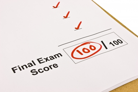 Final exam marked with 100% isolated on white. photo